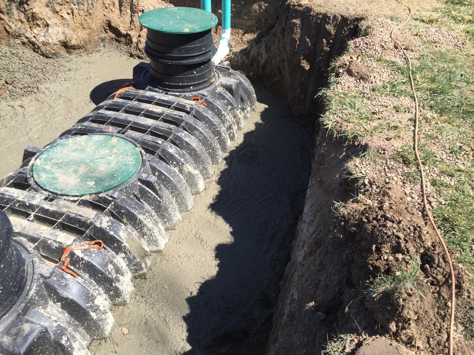 A concrete collar around a septic tank helps prevent it from floating in highly saturated soil.