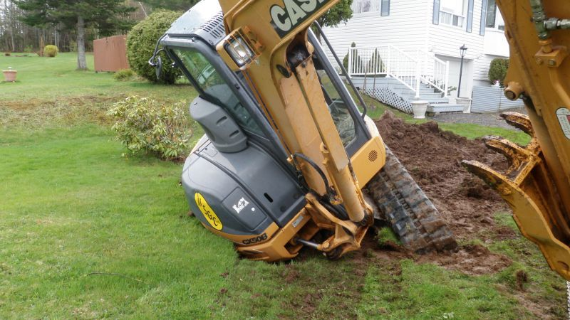 This is evidence of the job Mike Stairs will never forget. His Case excavator ran over the location of a deteriorating steel tank and collapsed into the mud.