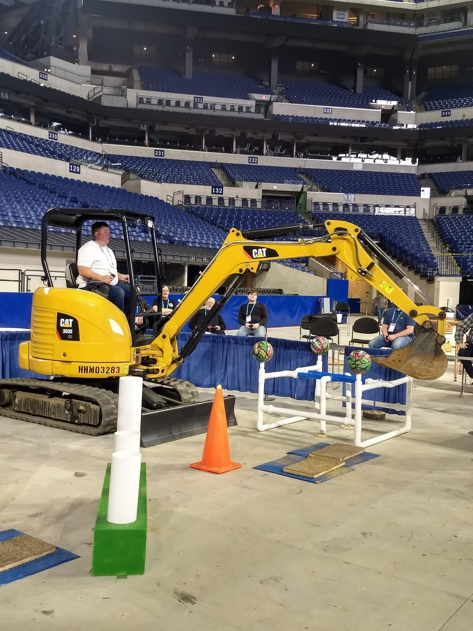 First-place winner John Moore is shown working on a Caterpillar mini-excavator at Lucas Oil Stadium.