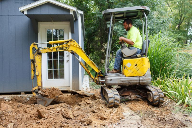 Dylan Stewart, of Stewart's Septic Services, uses a Kobelco mini-excavator to dig a trench for a line. (Photo by James Robinson)